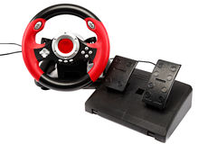 Game console with a steering wheel and pedals. Royalty Free Stock Photo