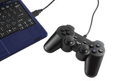 Game controller connected to keypad Royalty Free Stock Photo