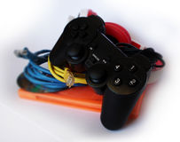 Game controller, disc and headphones Royalty Free Stock Photography