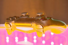 Game controller on illuminated Stock Photography