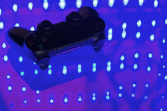 Game controller on illuminated. Table background. different colors Stock Photo