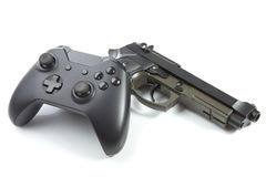 Game controller with real handgun near it Stock Photo