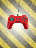 Game controller w clipping path. A red game controller isolated over a striped background with plenty of copyspace.  This file includes the clipping path for the Royalty Free Stock Photo