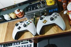 Game controllers on shelf Royalty Free Stock Photo