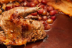Game Cookery.Roast pheasant with grape Stock Photography