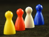 Game Counters. Four colourful Game counters or playing pieces frm a child`s game stock image