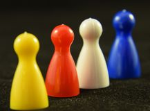 Game Counters. Four colourful Game counters or playing pieces frm a child`s game stock photos