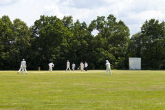 Game of Cricket. Playing cricket on Chislehurst Common on hot, summer day royalty free stock photos