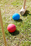 Game of croquet on green lawn Stock Photography