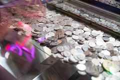 Game currency in the amusement machine. Elysburg, PA June 24 2018: Game currency in the amusement machine, Knoebels is a free-admission amusement park for Royalty Free Stock Images