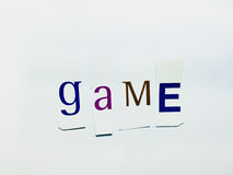 Game - Cutout Words Collage Of Mixed Magazine Letters with White Background. Caption composed with letters torn from magazines with White Background Royalty Free Stock Images