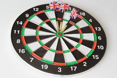 A game of darts with three flags of England on a white background stock images
