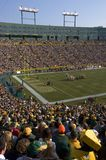 Game Day at Lambeau Field, Green Bay Packers NFL. Cheeseheads and Packer Fans cheer in excitement as the crowd roots for their Green Bay Packers at Lambeau Field