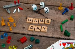 `Game Day` made from Scrabble game letters. Risk, Battleship pieces, Monopoly, Settler of Catan and other game pieces royalty free stock photo