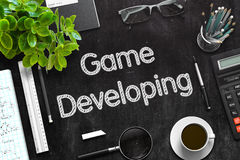 Game Developing Concept on Black Chalkboard. 3D Rendering. Royalty Free Stock Photos