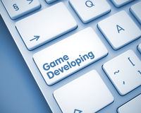 Game Developing - Text on the  Keyboard Key. 3D. Royalty Free Stock Photography