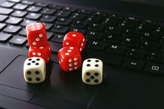 Game dice on a computer keyboard Stock Photos