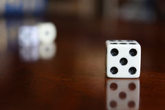 Game dice. A small cube with each side having a different number and used in gambling or other game Royalty Free Stock Photography