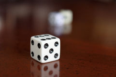 Game dice. A small cube with each side having a different number and used in gambling or other game Royalty Free Stock Image