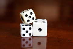 Game dice. A small cube with each side having a different number and used in gambling or other game Stock Images