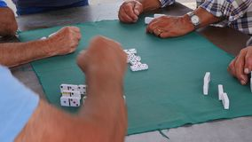 Game of Domino`s being played by men stock video footage