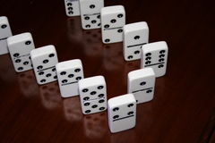Game of dominoes. On the wooden table Royalty Free Stock Images
