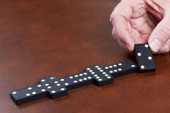 Game of dominoes on leather table Royalty Free Stock Photography
