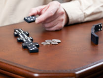 Game of dominoes on leather table Stock Photos