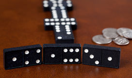 Game of dominoes on leather table Stock Images