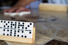 Game of dominos with friends Royalty Free Stock Image