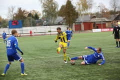 Game episode in a football match with contact Stock Photo
