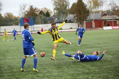 Game episode in a football match with contact Royalty Free Stock Image