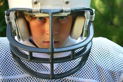 Game Face. Serious expression on face of boy in american football uniform Stock Image