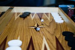 Game field in a backgammon with cubes and counters. Ame boards with thrown dice Stock Photography