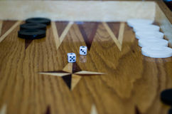 Game field in a backgammon with cubes and counters. Ame boards with thrown dice Royalty Free Stock Photo