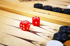 Game field in a backgammon with cubes and counters. Stock Image