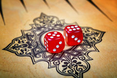 Game field in a backgammon with cubes Royalty Free Stock Photo