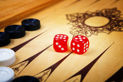 Game field in a backgammon with cubes and counters. Royalty Free Stock Photo