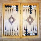 Game field in a backgammon with cubes and counters. Royalty Free Stock Image