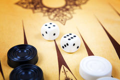 Game field in a backgammon with cubes and counters. Stock Photography