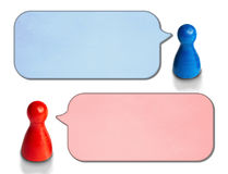 Game figures with angled speech bubbles  on white background. Concept for discussion, chat, communication. Game figures with angled speech bubbles  on white Stock Photo
