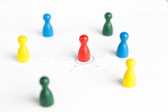 Game figurines outsource business diagram depicting community. On white Stock Images