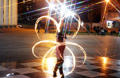 Game with fire. Fire show. Interesting fiery circles Royalty Free Stock Photography