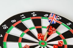 Playing darts with darts from the flags of England, dices. royalty free stock photos