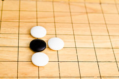Game go. Go game board , black and white stones royalty free stock photography