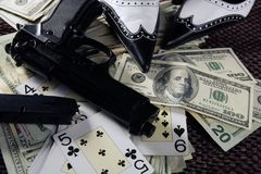 Game guns and dollars, clasic mafia gangster still. In low key Stock Photography