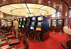 Game hall in Superfast  ship. Adriatic sea, August 2012: modern casino hall with game machines in Superfast ship. The Superfast ships operate in international Royalty Free Stock Images
