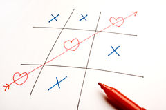 Game of Heart, Love and Flirt. A concept embedded into the game of tic-tac-toe by using the heart shape in game Stock Images