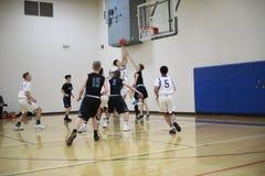 High School Basketball Game. A game of high school basketball stock photo