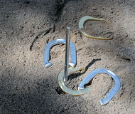 A Game of Horseshoes. Playing horseshoes and there is a ringer Stock Images